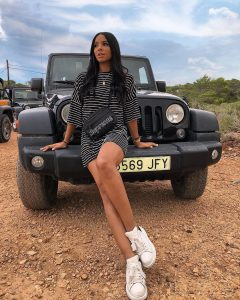 georgia bayliss posing in front of jeep party hard ibiza trip